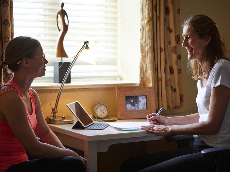 BATH Osteopath Katie Bench in consultation with a client
