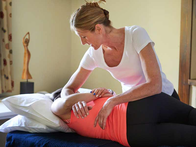 BA15 Osteopath Katie at Monkton Farleigh Osteopathic Practice treating a client